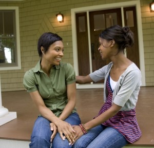Women talking on front porch